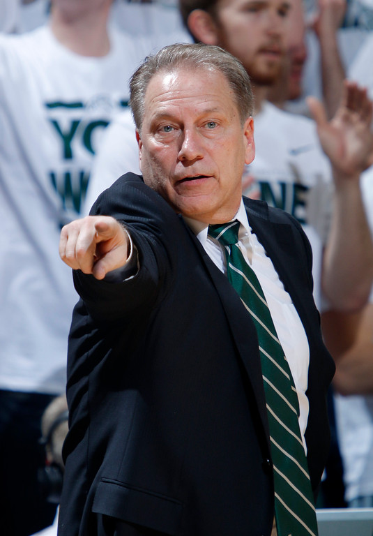 . Michigan State coach Tom Izzo gives instructions during the second half of an NCAA college basketball game against Michigan, Sunday, Feb. 1, 2015, in East Lansing, Mich. Michigan State won 76-66 in overtime. (AP Photo/Al Goldis)
