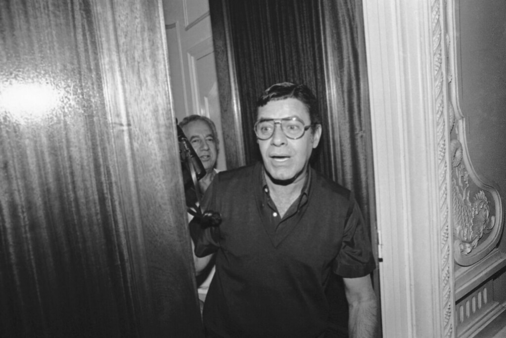 . American actor Jerry Lewis appears with camera on the door step of his Carlton hotel room at Cannes Film Festival, May 24, 1982, Cannes, France. (AP Photo/Jean Jacques Levy)