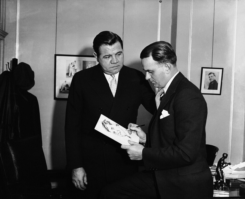 . AP sports cartoonist Thomas Paprocki is shown with Babe Ruth in an undated photo. (AP Photo)