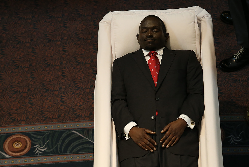 . The body of Rev. Clementa Pinckney lies in state during a public viewing at the South Carolina State House June 24, 2015 in Columbia, South Carolina. Pinckney was one of nine people killed during a Bible study inside Emanuel AME church in Charleston. U.S. President Barack Obama and Vice President Joe Biden are expected to attend the funeral which is set for Friday June 26 at the TD Arena.  (Photo by Joe Raedle/Getty Images)