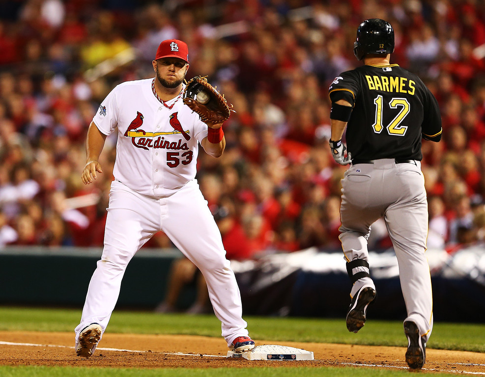 . Clint Barmes #12 of the Pittsburgh Pirates grounds out to first against Matt Adams #53 of the St. Louis Cardinals in the third inning during Game Five of the National League Division Series at Busch Stadium on October 9, 2013 in St Louis, Missouri.  (Photo by Elsa/Getty Images)