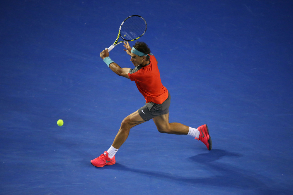 . Rafael Nadal of Spain plays a backhand in his semifinal match against Roger Federer of Switzerland during day 12 of the 2014 Australian Open at Melbourne Park on January 24, 2014 in Melbourne, Australia.  (Photo by Scott Barbour/Getty Images)