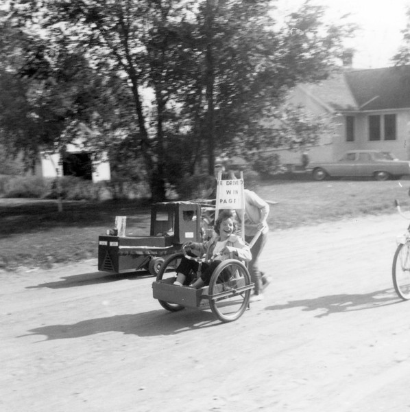 AR064.  Unknown‡ girl in cart – Arthur parade – 1963.jpg