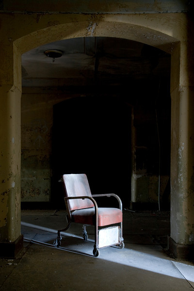 Geriatric chair in the hallway of the Lincoln ward at Worcester State Hospital.  This site has since been demolished.