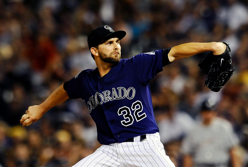 . Colorado Rockies starting pitcher Tyler Chatwood throws in the seventh inning of a baseball game against the Milwaukee Brewers, Friday, July 26, 2013, in Denver. The Rockies won 8-3. (AP Photo/Chris Schneider)