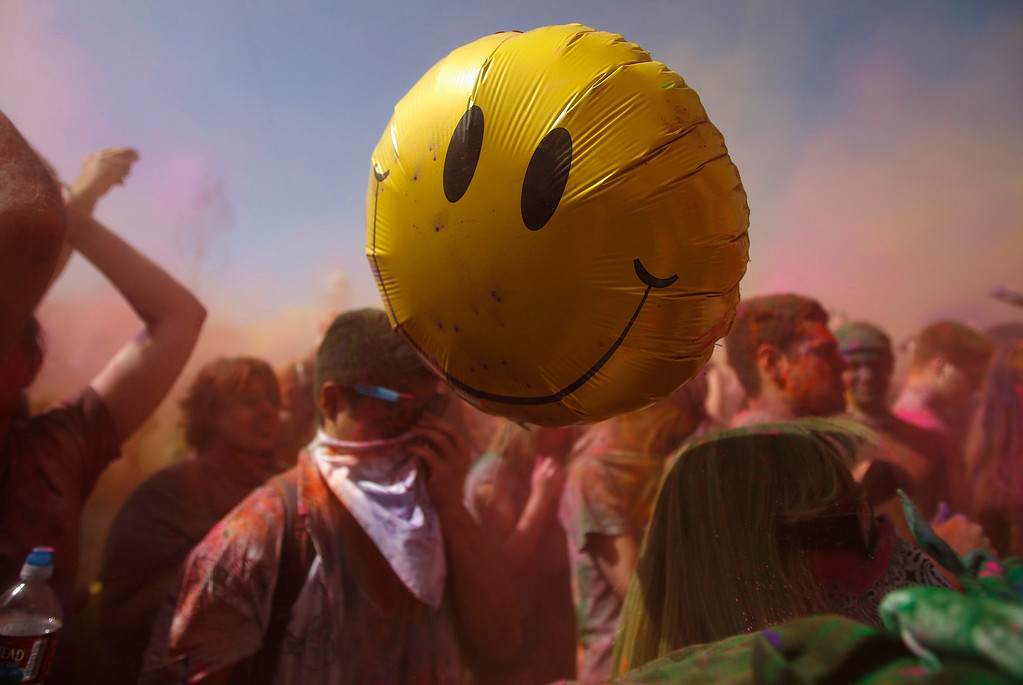 . A balloon floats away as participants dance and throw colored chalk during the Holi Festival of Colors at the Sri Sri Radha Krishna Temple in Spanish Fork, Utah, March 30, 2013.  REUTERS/Jim Urquhart