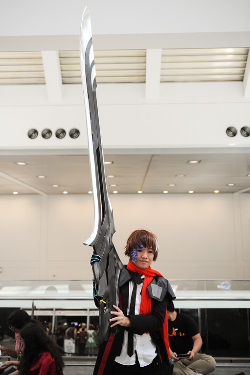 ". Kevin Sakagami holds a large sword while dressed as ""Shu\"" from Guilty Crown at the Anime Expo at the L.A. Convention Center, Saturday, July 6, 2013. (Michael Owen Baker/L.A. Daily News)"