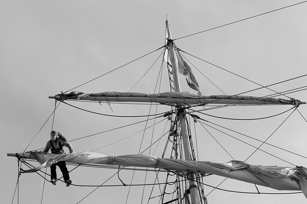 Female sailor working in the rigging