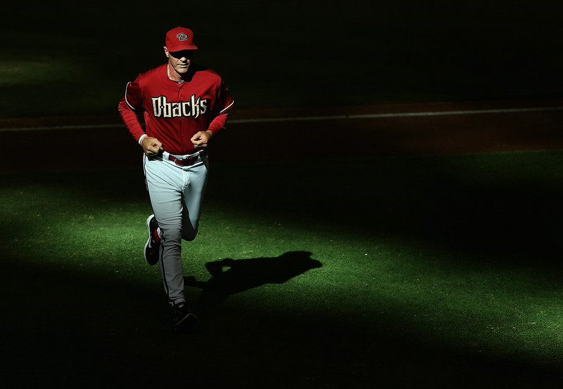 . Manager Kirk Gibson #23 of the Arizona Diamondbacks walks off the field during the tenth inning of the MLB game against the Colorado Rockies at Chase Field on August 10, 2014 in Phoenix, Arizona. The Rockies defeated the Diamondbacks 5-3 in 10 innings.  (Photo by Christian Petersen/Getty Images)