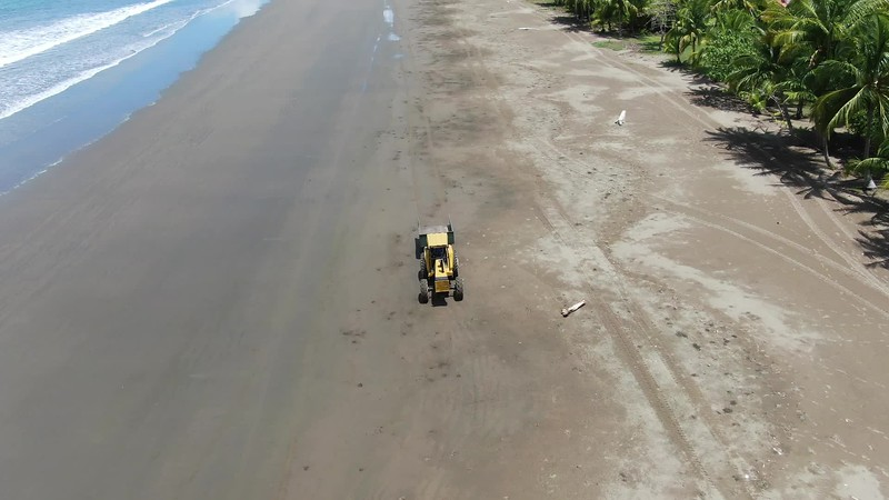 Tractor cleaning the beach