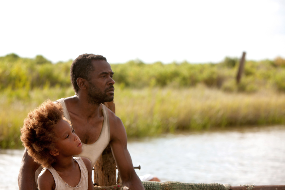 Description of . Quvenshane Wallis and Dwight Henry portray Hushpuppy and her dad, Wink, in