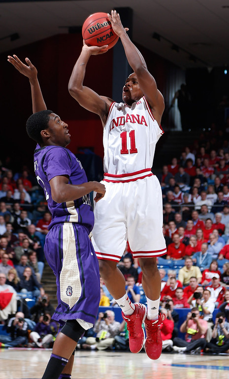. DAYTON, OH - MARCH 22: Yogi Ferrell #11 of the Indiana Hoosiers shoots against Ron Curry #2 of the James Madison Dukes in the second half during the second round of the 2013 NCAA Men\'s Basketball Tournament at UD Arena on March 22, 2013 in Dayton, Ohio.  (Photo by Joe Robbins/Getty Images)