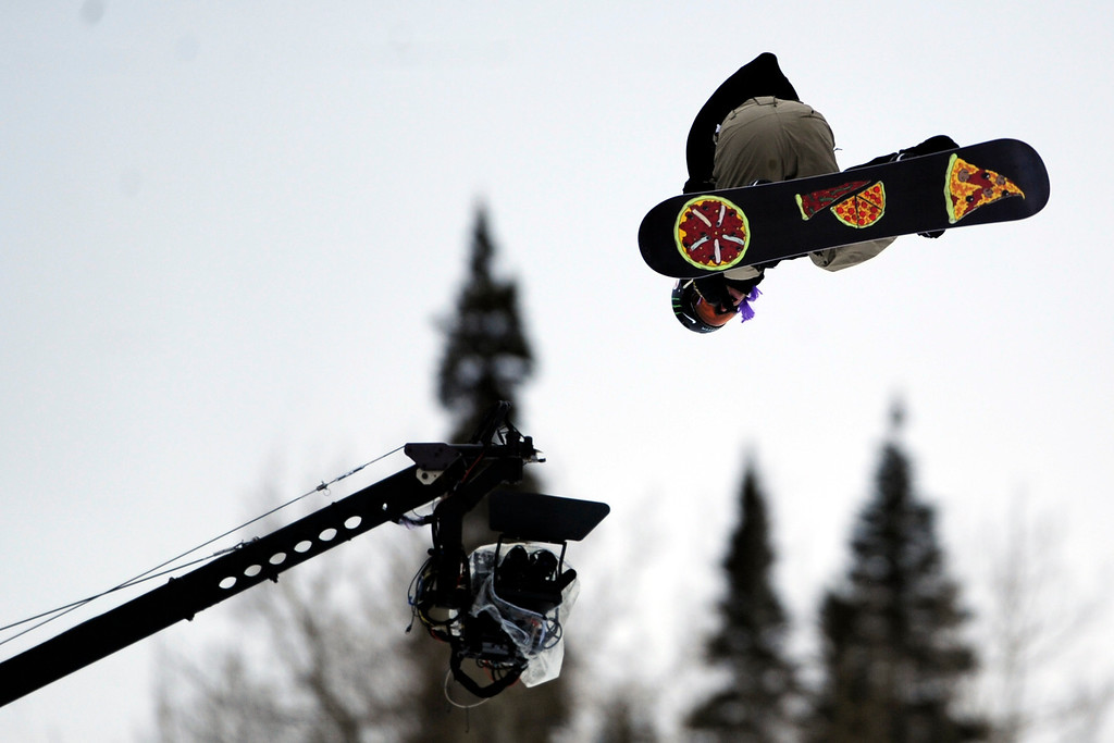 . ASPEN, CO. - JANUARY 24: Sage Kotsenburg hits a jump during the men\'s Snowboard Slopestyle elimination. Men\'s Snowboard Slopestyle elimination X Games Aspen Buttermilk Mountain Aspen January 24, 2013. (Photo By AAron Ontiveroz / The Denver Post)