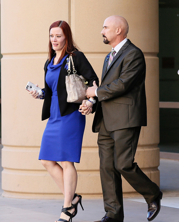 . Tanisha Sorenson, sister of murder victim Travis Alexander, leaves the court house, Thursday, March 5, 2015, in Phoenix. A judge declared a mistrial Thursday in the Jodi Arias sentencing retrial after a jury deadlocked on whether the convicted murderer should be executed or sent to prison for life for the 2008 killing of Travis Alexander.(AP Photo/Matt York)