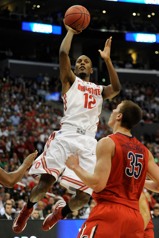 . Ohio State #12 Sam Thompson goes to the hoop against Arizona #35 Kaleb Tarczewski in the first half. Arizona and Ohio State met at Staples Center for the West Regional of the NCAA Division I Men\'s Basketball Championships. Los Angeles,CA 3/28/2013(John McCoy/Staff Photographer