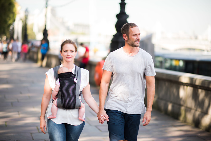 Izmi_Baby_Carrier_Breeze_Mid_Grey_Lifestyle_Front_Carry_Couple_Holding_Hands_By_River.jpg