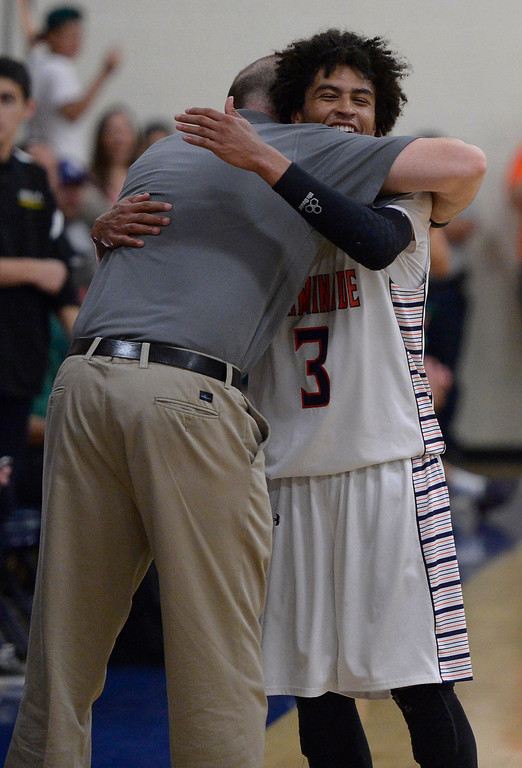 . Chaminade#3 Justin Eisen gets a hug after being pulled out of the game during the final moments. The boys from Chaminade defeated Brea Olinda 77-49 in a state regional semifinals game. West Hills, CA. March 18, 2014 (Photo by John McCoy / Los Angeles Daily News)