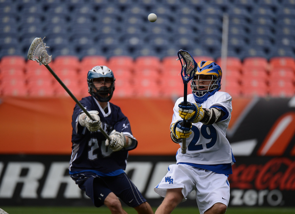 . DENVER, CO. - MAY 18 : John Roach of Wheat Ridge High School (29) makes a pass by Jase Wyeno of Air Academy High School (20) during the first half of  4A Boy\'s Lacrosse Championship game at Sports Authority Field at Mile High Stadium. Denver, Colorado. May 18, 2013. (Photo By Hyoung Chang/The Denver Post)