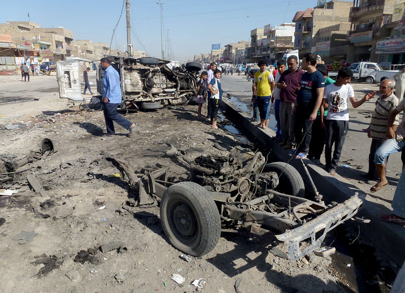 . Iraqis inspect the site of a car bomb explosion in the impoverished district of Sadr City in Baghdad\'s on July 29, 2013, after 11 car bombs hit nine different areas of Baghdad, seven of them Shiite-majority, while another exploded in Mahmudiyah to the south of the capital.  More than 3,000 people have been killed in violence since the beginning of the year, according to AFP figures based on security and medical sources -- a surge in unrest that the Iraqi government has so far failed to stem.  AHMAD AL-RUBAYE/AFP/Getty Images