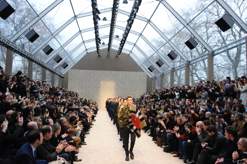 . Models walk the runway at the Burberry AW14 Menswear Show at Kensington Gardens on January 8, 2014 in London, England.  (Photo by Anthony Harvey/Getty Images)