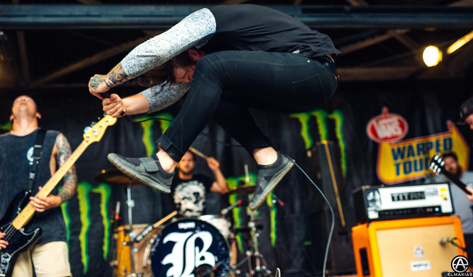 Caleb Shomo of Beartooth live at Vans Warped Tour 2015 by Adam Elmakias