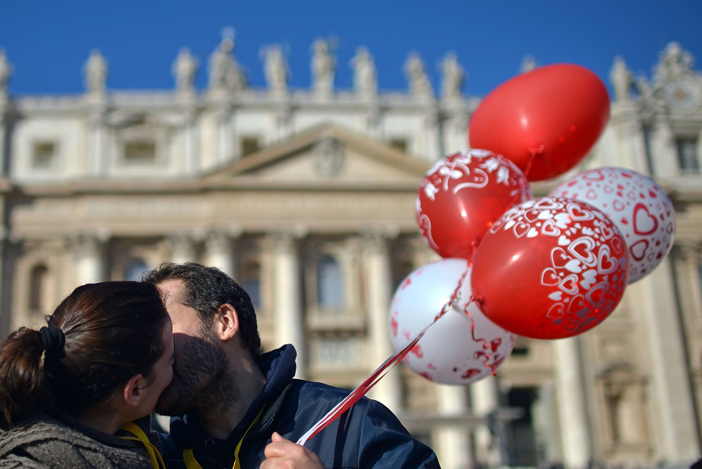 . An engaged couple kiss during a Valentine\'s Day celebration in St Peter\'s square at the Vatican on February 14, 2014. The Vatican said there were around 20,000 future brides and grooms attending from 25 countries, all of them enrolled on Catholic marriage preparation courses. The celebration was not open to same-sex couples as Francis is opposed to gay marriage, even though he has called for a more tolerant approach to homosexuals. AFP PHOTO / GABRIEL BOUYS/AFP/Getty Images