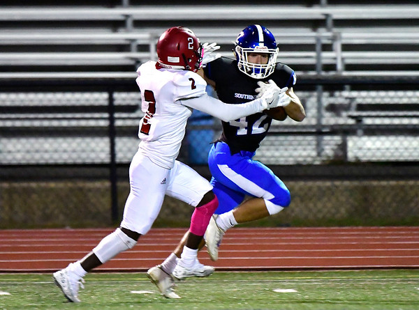 10/11/2019 Mike Orazzi | StaffrSouthingtons Dillon Kohl (42) and Machester's Rexford Ageymang (2) during Friday night's football game in Southington.