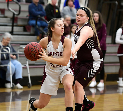 2/8/2019 Mike Orazzi | Staff Bristol Central's Gwen Torreso (20) and Innovation's Lydia Bishop (25) during Friday night's girls basketball game in Bristol.