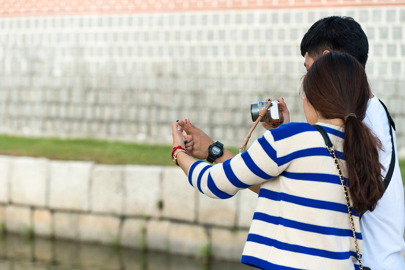 Couple photographing their finger pose, Seoul, South Korea