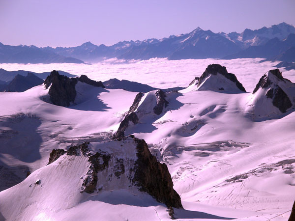 However, successful descent of the ridge delivers the climber to the glacial plain, from which an entire horizon on mountains awaits, begging to be climbed.