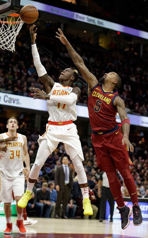 . Atlanta Hawks\' Dennis Schroder (17), from Germany, drives to the basket against Cleveland Cavaliers\' JR Smith (5) in the first half of an NBA basketball game, Tuesday, Dec. 12, 2017, in Cleveland. (AP Photo/Tony Dejak)