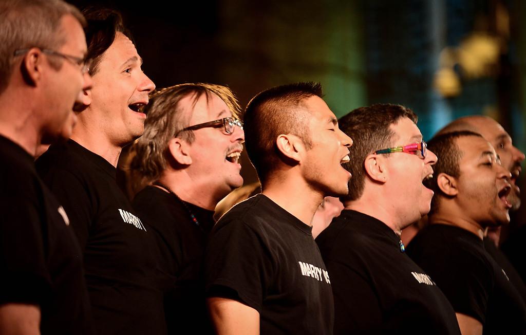 . Members of the Twin Cities Gay Men\'s Chorus perform at Ecolab Plaza. (Pioneer Press: Ben Garvin)