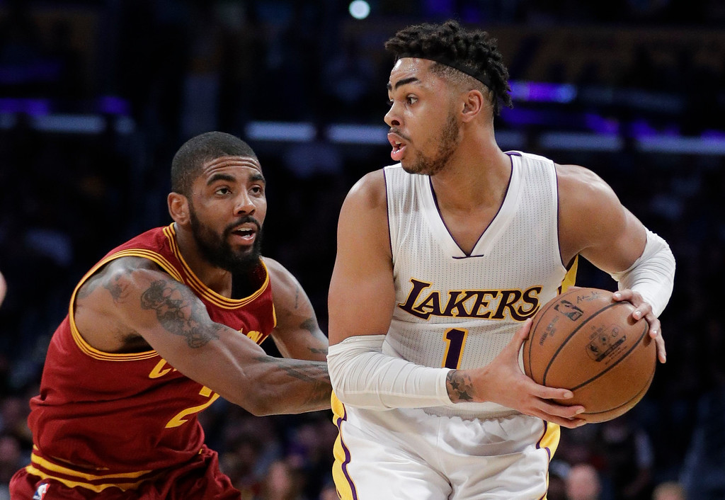 . Los Angeles Lakers\' D\'Angelo Russell, right, is pressured by Cleveland Cavaliers\' Kyrie Irving during the first half of an NBA basketball game Sunday, March 19, 2017, in Los Angeles. (AP Photo/Jae C. Hong)
