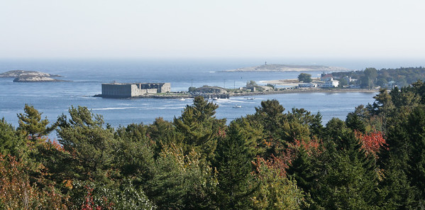 Fort Popham and Popham Village with Pond Island lighthouse in the background, fall foliage looking across Atkins Bay from the Wilbur Preserve, Coxs Head, Phippsburg, Maine,  iconic Maine lighthouse, classic Maine coastal scenic, marine navigational devices