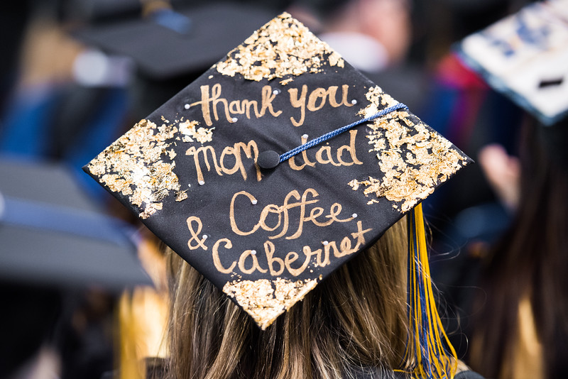 A graduate's hat features a thank-you message at UAF's commencement ceremony at the Carlson Center on May 5, 2018.