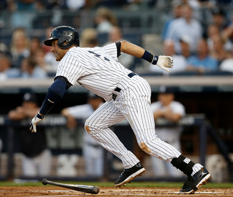 . New York Yankees Derek Jeter runs out a groundout in a baseball game against the Detroit Tigers at Yankee Stadium in New York, Wednesday, Aug. 6, 2014.  (AP Photo/Kathy Willens)
