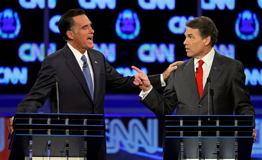 . FILE - In this Oct. 18, 2011 file photo, Republican presidential candidates former Massachusetts Gov. Mitt Romney, left, and Texas Gov. Rick Perry speak during a Republican presidential debate in Las Vegas. Perry announced Monday, July 8, 2013, that he would not seek re-election as Texas governor next year. (AP Photo/Chris Carlson, File)