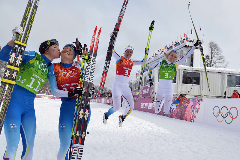 . From left to right: Finland\'s Aino-Kaisa Saarinen and Kerttu Niskanen celebrate their silver as Sweden\'s Ida Ingemarsdotter and Stina Nilsson celebrate winning bronze at the finish line in the Women\'s Cross-Country Skiing Team Sprint Classic Final at the Laura Cross-Country Ski and Biathlon Center during the Sochi Winter Olympics on February 19, 2014 in Rosa Khutor near Sochi.  (ALBERTO PIZZOLI/AFP/Getty Images)