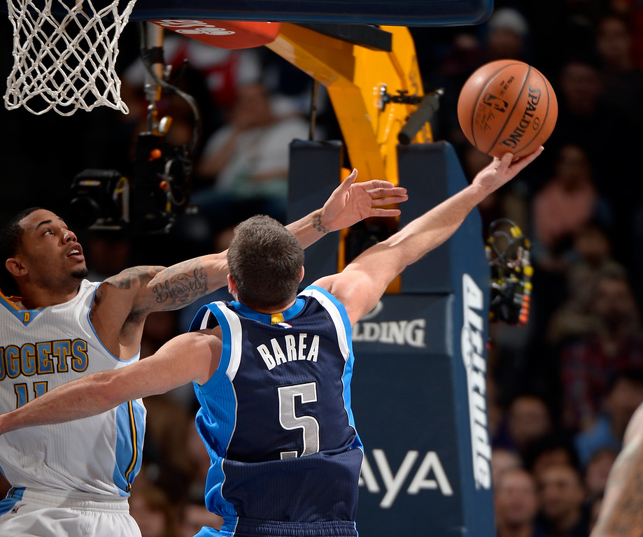 . DENVER, CO - JANUARY 14: Dallas Mavericks guard J.J. Barea (5) goes up for a shot on Denver Nuggets guard Erick Green (11) during the second quarter January 14, 2015 at Pepsi Center. (Photo By John Leyba/The Denver Post)