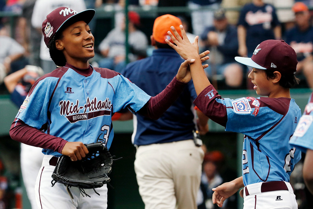 . Pennsylvania pitcher Mo\'ne Davis, left, celebrates with teammate Jack Rice (2) after getting the final out of a 4-0 shutout against Tennessee during a baseball game in United States pool play at the Little League World Series tournament in South Williamsport, Pa., Friday, Aug. 15, 2014. (AP Photo/Gene J. Puskar)