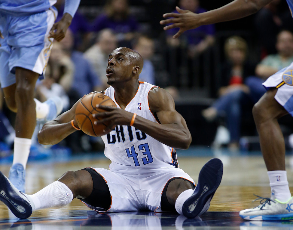 . Charlotte Bobcats forward Anthony Tolliver passes after gaining possession of a loose ball against the Denver Nuggets during the first half of an NBA basketball game in Charlotte, N.C., Monday, March 10, 2014. Charlotte won 105-98. (AP Photo/Nell Redmond)