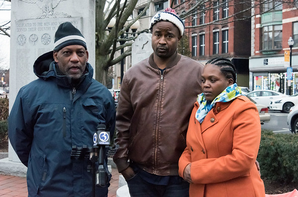 12/14/18 Wesley Bunnell | Staff Activists and family members spoke on Friday afternoon at Central Park, across from city hall, in remembrance of the police involved shooting on Chapman St one year ago. Activist Cornell Lewis speaks with members of the media while standing next to William Tisdol and Donde Morell, parents of Caleb Tisdol who was shot by police.