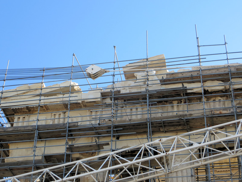You can see where part of the pediment on the west side has been removed.  It will eventually be replaced.