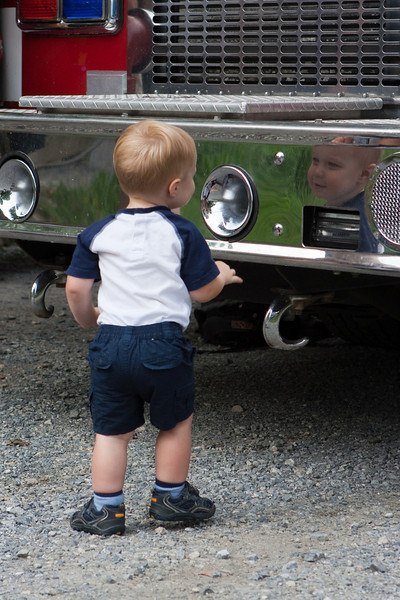 Ethan inspects the polished bumper.