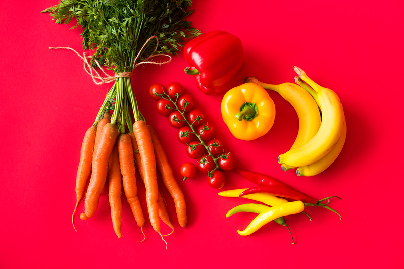fresh-fruits-and-vegetables-on-red-background-still-life-picjumbo-com.jpg