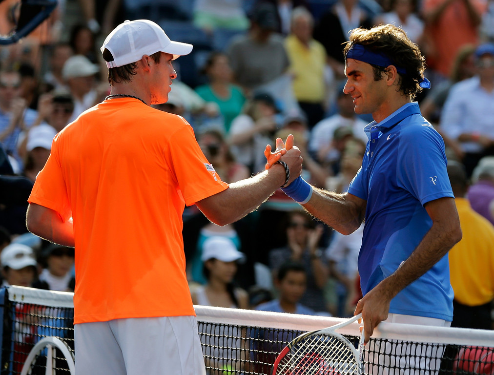 . Roger Federer, of Switzerland, greets Grega Zemlja, of Slovenia, after winning their first round match of the 2013 U.S. Open tennis tournament Tuesday, Aug. 27, 2013, in New York. (AP Photo/Mike Groll)