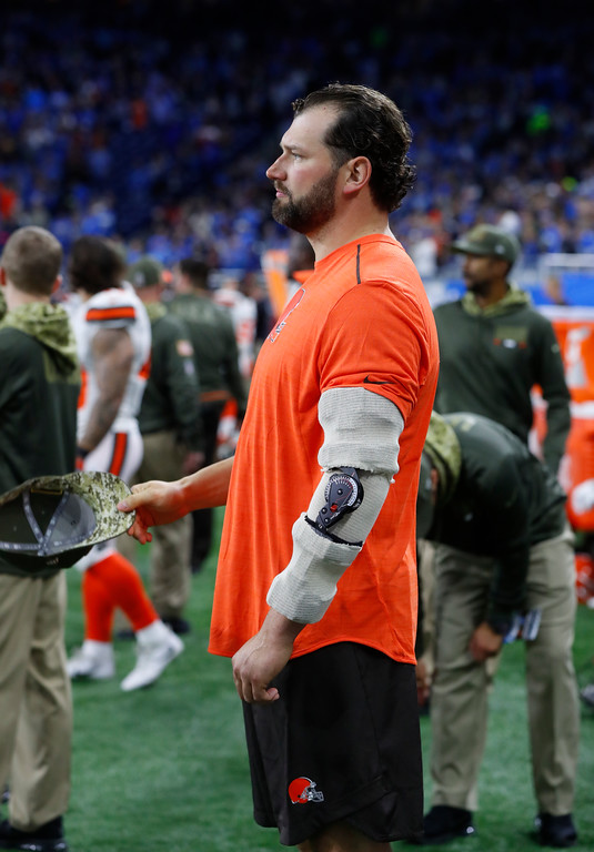 . Cleveland Browns offensive tackle Joe Thomas, wearing an arm brace for a torn triceps, watches against the Detroit Lions during an NFL football game in Detroit, Sunday, Nov. 12, 2017. (AP Photo/Paul Sancya)