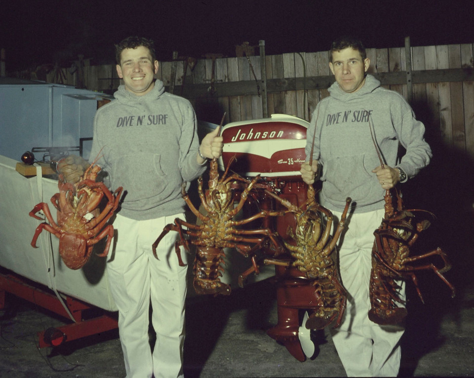 . Bill Meistrell left and Bob Meistrell right with lobsters caught off the coast. Body Glove Photo