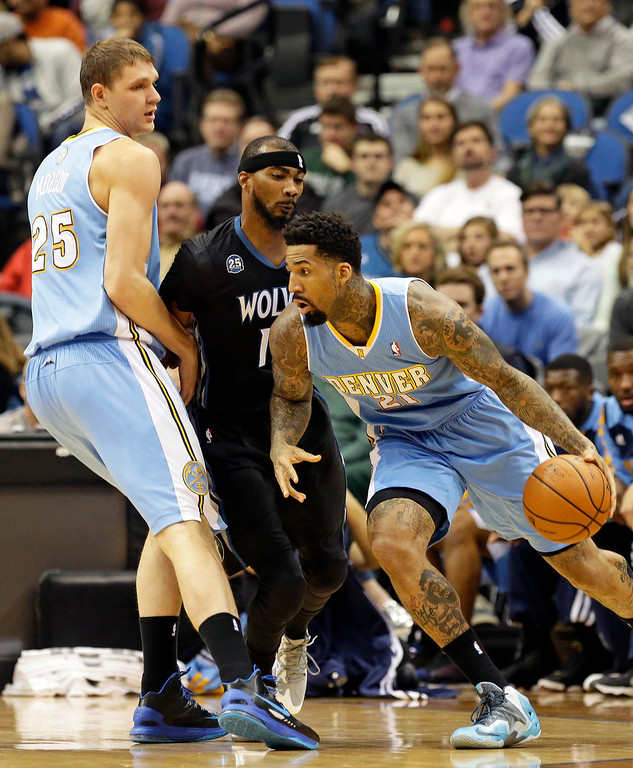 . Denver Nuggets\' Kenneth Faried, left, sets a pick on Minnesota Timberwolves\' Corey Brewer as Nuggets\' Wilson Chandler, right, drives by in the first quarter of an NBA basketball game, Wednesday, Nov. 27, 2013, in Minneapolis. (AP Photo/Jim Mone)