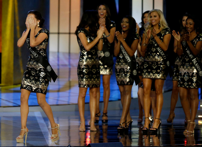 . Miss Idaho Sierra Sandison, left, celebrates after she\'s announced as a finalist during the Miss America 2015 pageant, Sunday, Sept. 14, 2014, in Atlantic City, N.J. (AP Photo/Mel Evans)